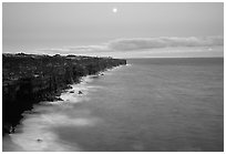 Holei Pali cliffs and moon at dusk. Hawaii Volcanoes National Park, Hawaii, USA. (black and white)