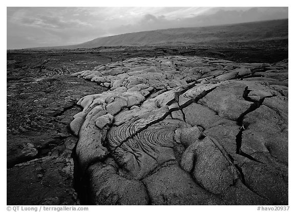 Fresh lava with cracks showing molten lava underneath. Hawaii Volcanoes National Park (black and white)