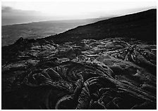 Hardened lava flow, coast in the distance. Hawaii Volcanoes National Park ( black and white)