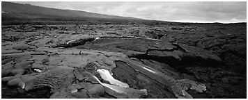 Volcanic landscape with molten lava low. Hawaii Volcanoes National Park (Panoramic black and white)