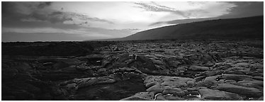 Landscape with red lava flow at sunset. Hawaii Volcanoes National Park (Panoramic black and white)