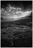 Live lava flow on coastal plain sunset. Hawaii Volcanoes National Park, Hawaii, USA. (black and white)