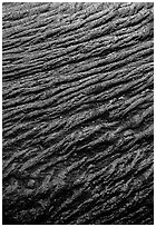 Ripples of flowing pahoehoe lava detail. Hawaii Volcanoes National Park, Hawaii, USA. (black and white)