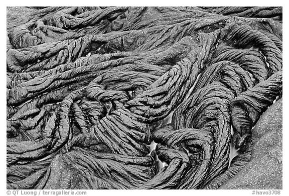 Braids of pahoehoe lava with red hot lava showing through cracks. Hawaii Volcanoes National Park (black and white)