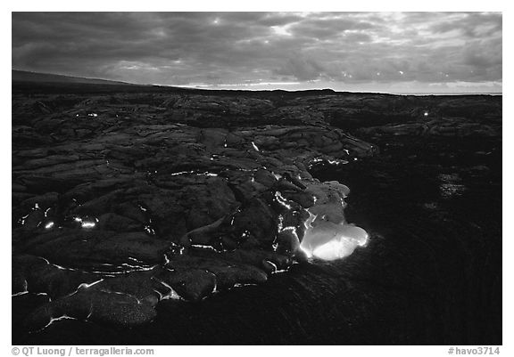Red lava glows at dawn. Hawaii Volcanoes National Park (black and white)