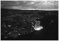 Red lava glows at dawn. Hawaii Volcanoes National Park, Hawaii, USA. (black and white)