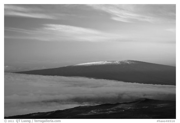 Snowy Mauna Loa above clouds at sunrise. Hawaii Volcanoes National Park (black and white)