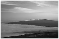 Snowy Mauna Loa above clouds at sunrise. Hawaii Volcanoes National Park, Hawaii, USA. (black and white)