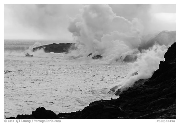 Steam rising off lava flowing into ocean. Hawaii Volcanoes National Park (black and white)
