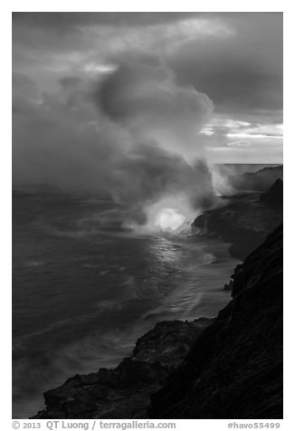 Coastline with steam illuminated by molten lava. Hawaii Volcanoes National Park (black and white)