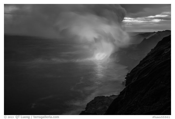 Coastline with steam lit by hot lava. Hawaii Volcanoes National Park (black and white)