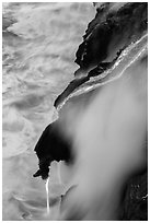 Ribbons of lava flow into the Pacific Ocean. Hawaii Volcanoes National Park, Hawaii, USA. (black and white)