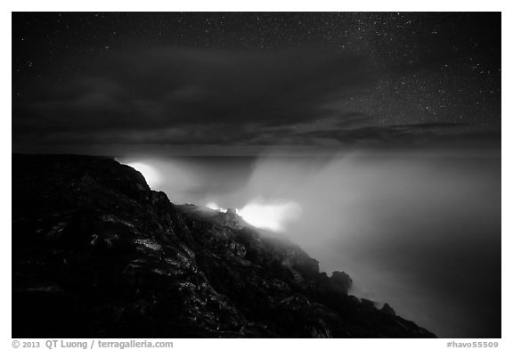 Lava makes contact with ocean on a stary night. Hawaii Volcanoes National Park (black and white)
