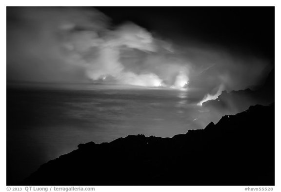Hydrochloric steam clouds glow by lava light on coast. Hawaii Volcanoes National Park (black and white)