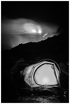 Camping by lava flow next to ocean. Hawaii Volcanoes National Park, Hawaii, USA. (black and white)