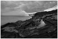 Surface lava flow on the coast. Hawaii Volcanoes National Park, Hawaii, USA. (black and white)