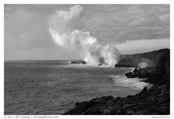 Billowing coastal smoke plume carries toxic sulphur dioxide as lava enters Pacific Ocean. Hawaii Volcanoes National Park (black and white)