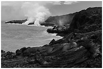 Molten lava flow and ocean plume. Hawaii Volcanoes National Park, Hawaii, USA. (black and white)