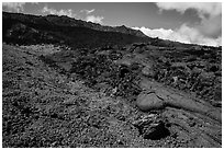 Olivine crystals, red lava rock, and lava fields, Mauna Loa. Hawaii Volcanoes National Park, Hawaii, USA. (black and white)