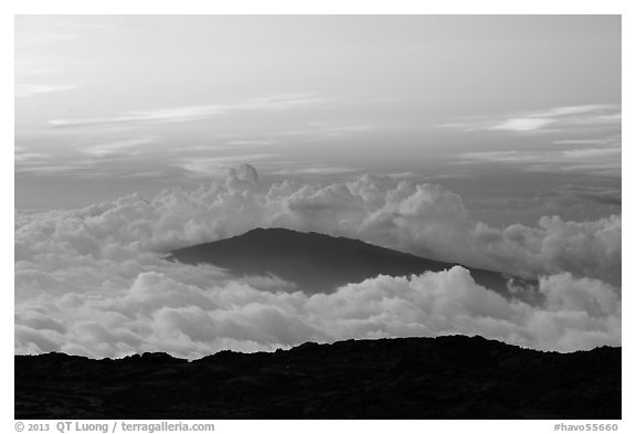 Puu Waawaa summit emerging from sea of clouds at sunset. Hawaii Volcanoes National Park (black and white)