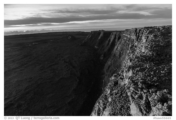 Cliffs bordering Mauna Loa summit caldera from rim at sunrise. Hawaii Volcanoes National Park (black and white)