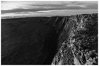 Cliffs bordering Mauna Loa summit caldera from rim at sunrise. Hawaii Volcanoes National Park, Hawaii, USA. (black and white)