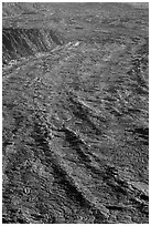 Waves of lava on Mokuaweoweo crater floor. Hawaii Volcanoes National Park, Hawaii, USA. (black and white)
