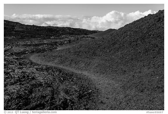 Trail through olivine hill bordering aa lava. Hawaii Volcanoes National Park (black and white)