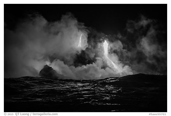 Lava cascades lighting ocean at night. Hawaii Volcanoes National Park (black and white)