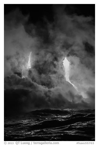 Lava cascading cliffs above ocean waves at night. Hawaii Volcanoes National Park (black and white)