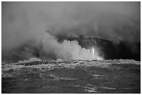 Lava flows creating huge clouds of hydrochloric steam upon meeting with ocean. Hawaii Volcanoes National Park, Hawaii, USA. (black and white)
