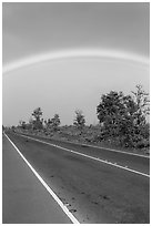 Rainbow above highway. Hawaii Volcanoes National Park, Hawaii, USA. (black and white)