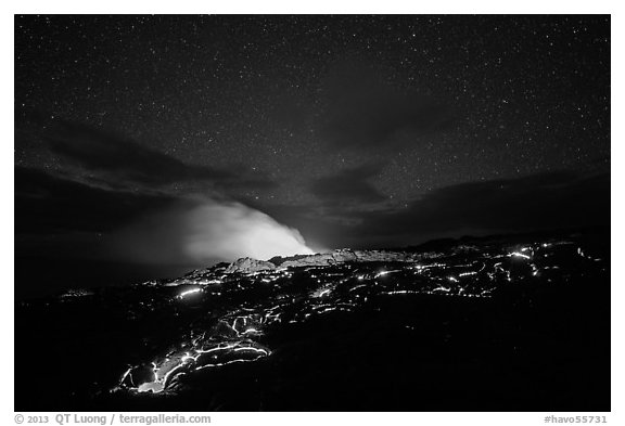 Molten lava flow and plume from ocean entry with stary sky at night. Hawaii Volcanoes National Park (black and white)