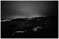 Molten lava flow with star trails. Hawaii Volcanoes National Park, Hawaii, USA. (black and white)