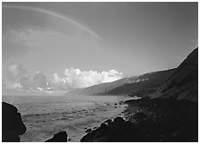 Rainbow and Mataalaosagamai sea cliffs in the distance, Tau Island. National Park of American Samoa (black and white)