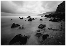 Seascape with smooth water, clouds and rocks, Siu Point, Tau Island. National Park of American Samoa (black and white)
