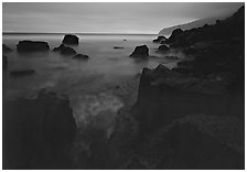 Rocky coastline at dusk, Siu Point, Tau Island. National Park of American Samoa (black and white)