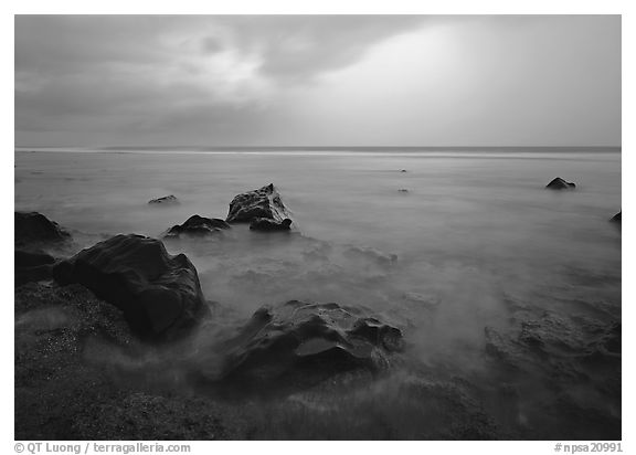 Rocks in water and approaching storm, Siu Point, Tau Island. National Park of American Samoa (black and white)