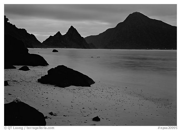 Beach and pointed peaks at dusk, Ofu Island. National Park of American Samoa (black and white)