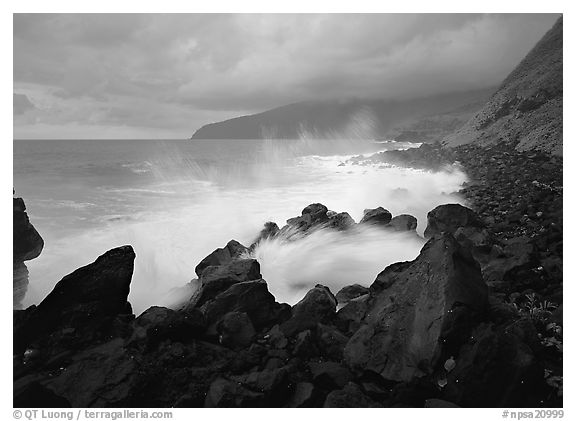 Stormy ocean and balsalt boulders, Siu Point, Tau Island. National Park of American Samoa (black and white)