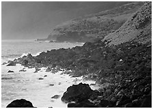 Coastline with Balsalt boulders on the wild South coast of Tau Island. National Park of American Samoa ( black and white)