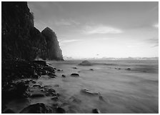 Foamy water and Pola Island at dawn, Tutuila Island. National Park of American Samoa ( black and white)