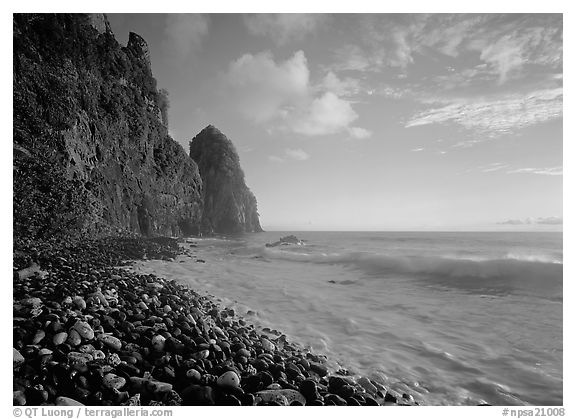 Beach with pebbles and Pola Island, early morning, Tutuila Island. National Park of American Samoa (black and white)