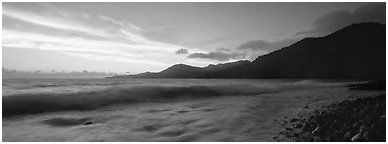 Wave and coastal hills at dawn, Tutuila Island. National Park of American Samoa (Panoramic black and white)