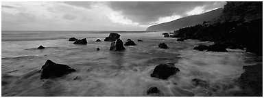 Dynamic seascape with boulders and surf, Tau Island. National Park of American Samoa (Panoramic black and white)