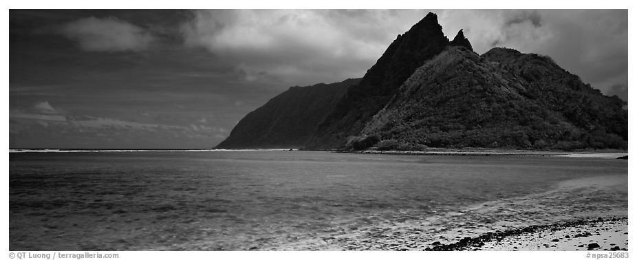 Tropical landscape with blue waters, pointed peaks, and clouds, Ofu Island. National Park of American Samoa (black and white)