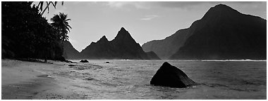 Tropical peaks raising abruptly above beach, Ofu Island. National Park of American Samoa (Panoramic black and white)