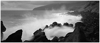 Shoreline with black rock pounded by strong surf, Tau Island. National Park of American Samoa (Panoramic black and white)