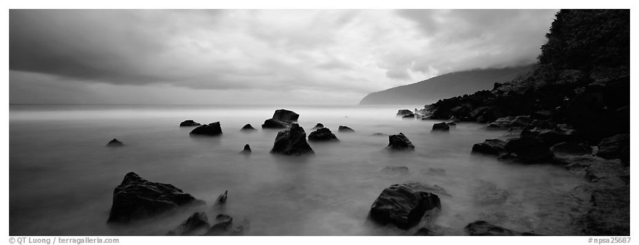 Coast with boulders and storm clouds, Tau Island. National Park of American Samoa (black and white)