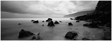 Coast with boulders and storm clouds, Tau Island. National Park of American Samoa (Panoramic black and white)